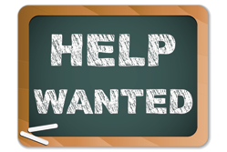 Help Wanted written on Chalk Blackboard