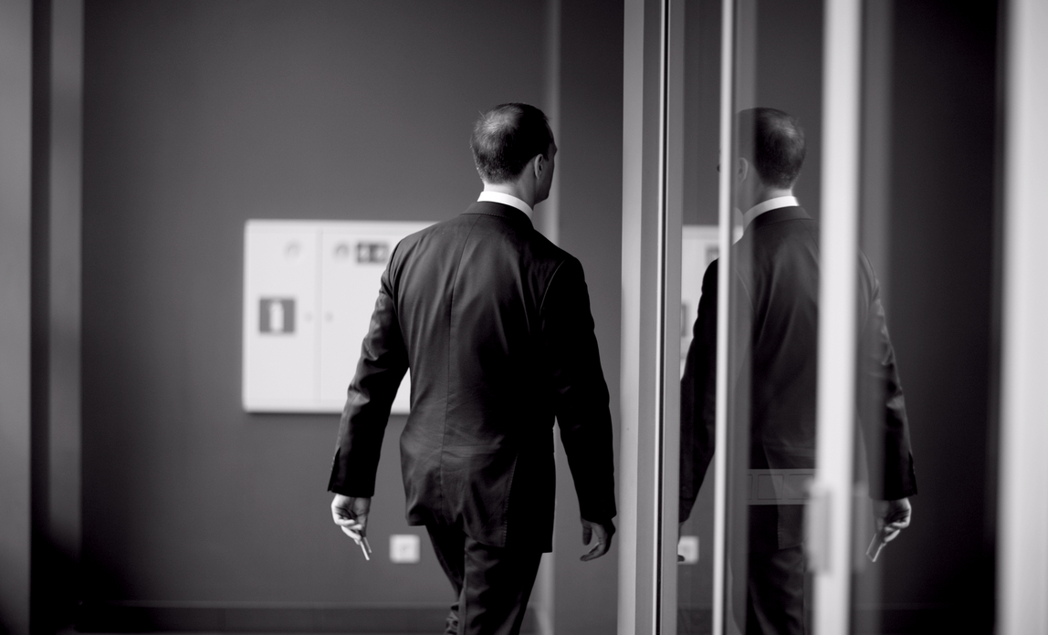 Man walking through office door - How to manage an employee's departure