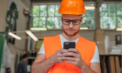 Builder using a finance app while during his working day