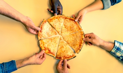 Multiple company employees equally share a cheese pizza