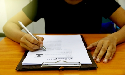 Man signing an employment contract
