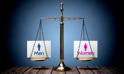 Justice scale with 'Men' and 'Women' in the two sides of the scales