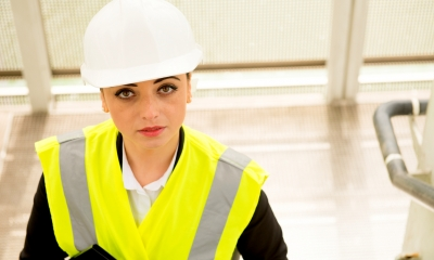 Woman in hard hat - Health and safety risk assessment