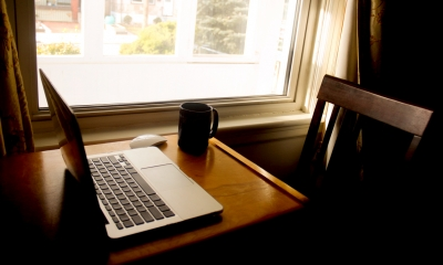 Laptop on desk at home - Homeworking - a guide for employers and employees