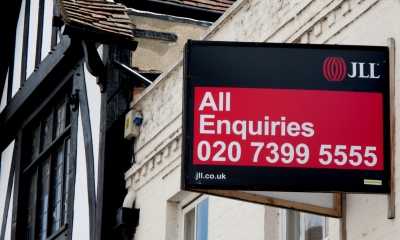 Estate agent's board on a commercial property that is being advertised as a premises for lease