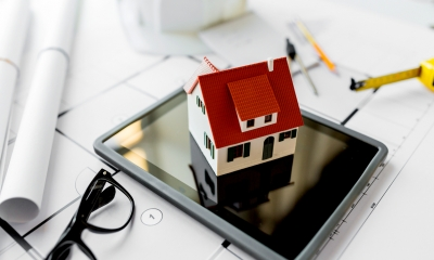 Miniature house on a tablet - Online planning application tool