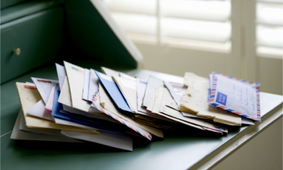 A big pile of post on a desk