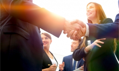 Group of businesspeople – shake hands agreeing to collaborate