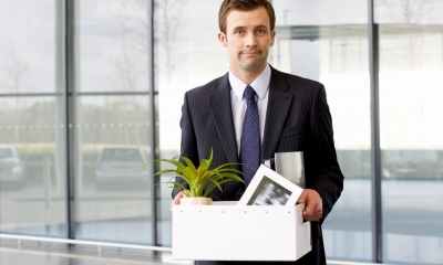 Man leaving office  with possessions - Redundancy FAQs