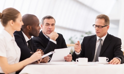 Business people sitting at a table holding a discussion