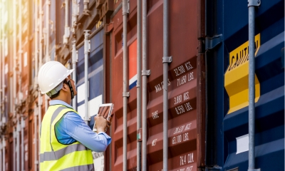 Dockyard worker checking ship containers