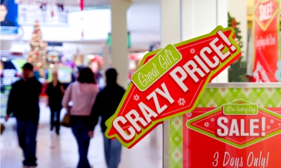 'Crazy price' sign in busy shopping mall