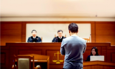 A witness gives evidence in court in front of three magistrates.
