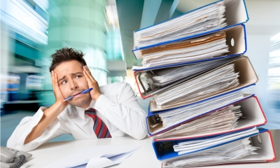 Businessman overwhelmed with the amount of work to be done