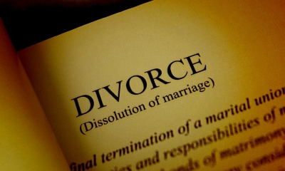 Dictionary open on the page for Divorce showing a written explanation of the word