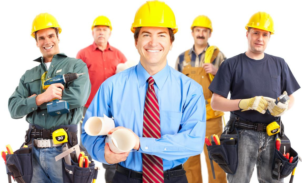 Construction manager holding building plans with four different tradesmen behind him