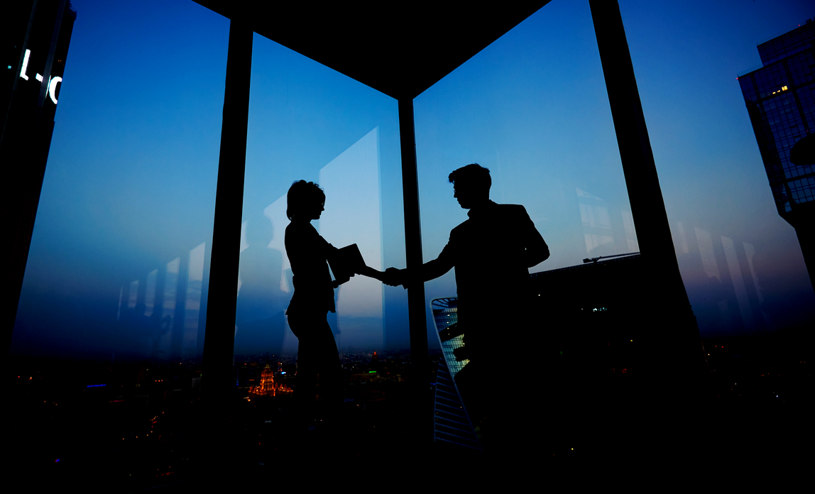 Man and woman shaking hands - Joint ventures FAQs