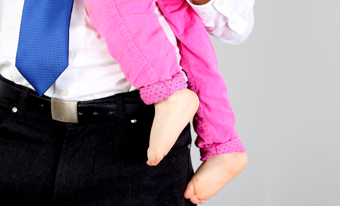 Businessman holding a child