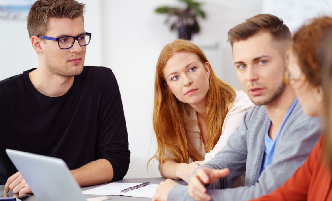A group of business people having a discussion