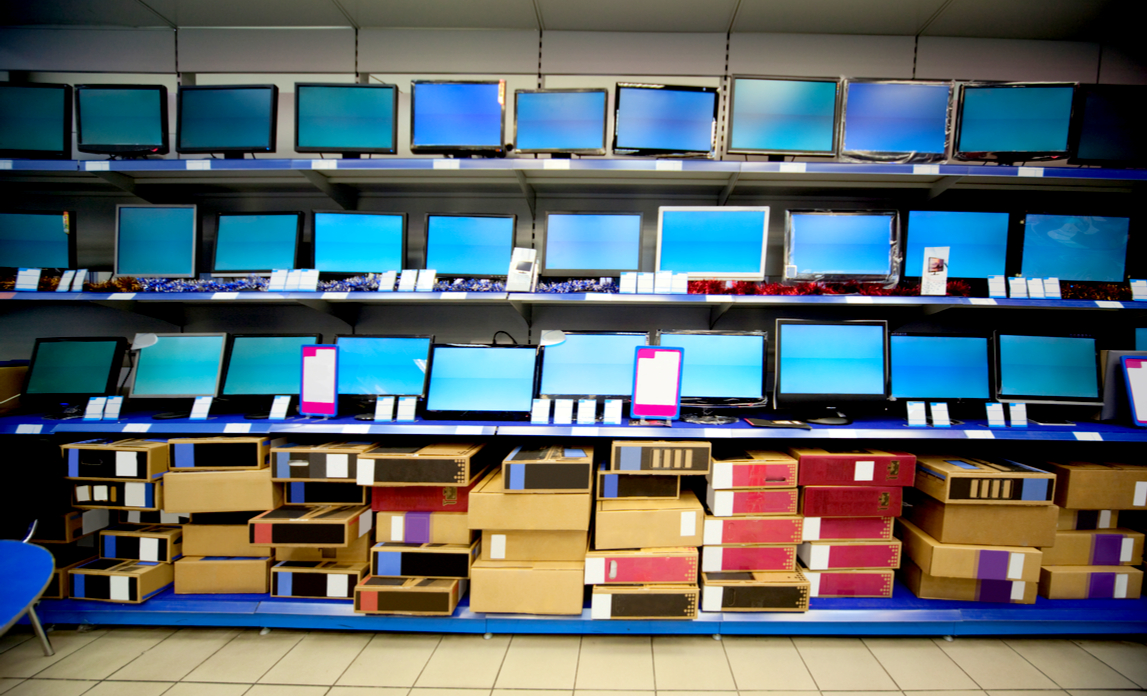 Shelves of laptops for sale in an IT retailer