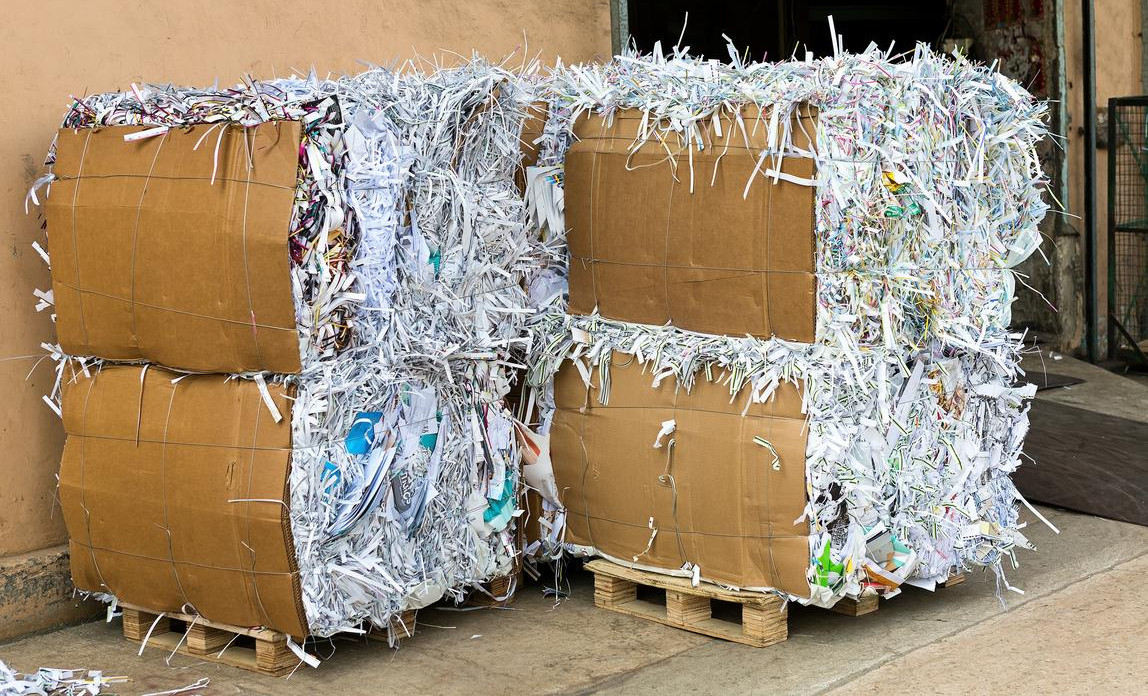 Shredded paper on pallets ready for waste collection